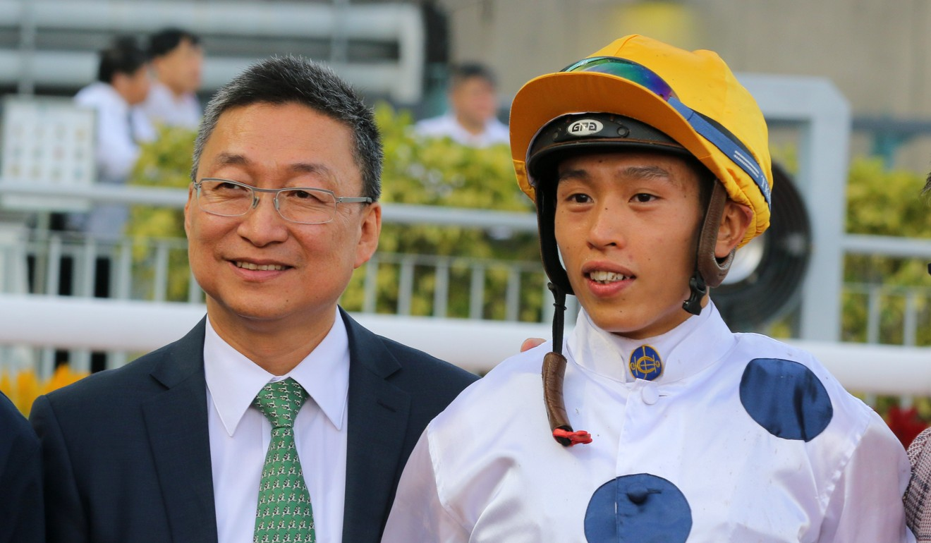 Trainer Francis Lui with jockey Vincent Ho at Sha Tin after a winner this season.