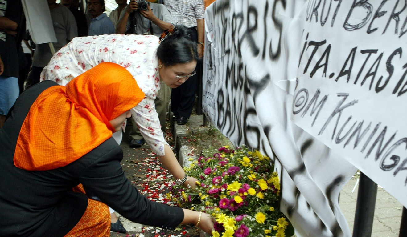 Indonesians lay flowers outside the Australian Embassy in Jakarta in September 2004, a day after a huge bomb exploded. The al-Qaeda-linked group Jemaah Islamiah claimed responsibility for the attack. Photo: EPA