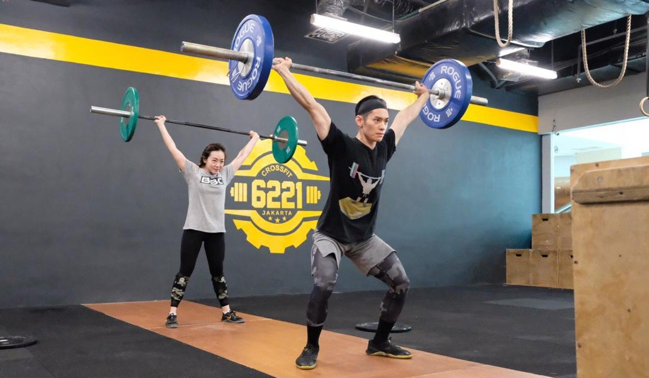 Mahendra Arditirta working out with his girlfriend at CrossFit 6221 in Jakarta. Photo: Handout