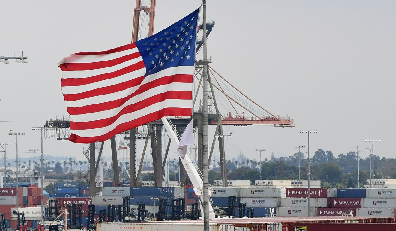 A US flag flies at the Port of Los Angeles as the US-China trade war stretches past the one-year mark. Photo: AFP