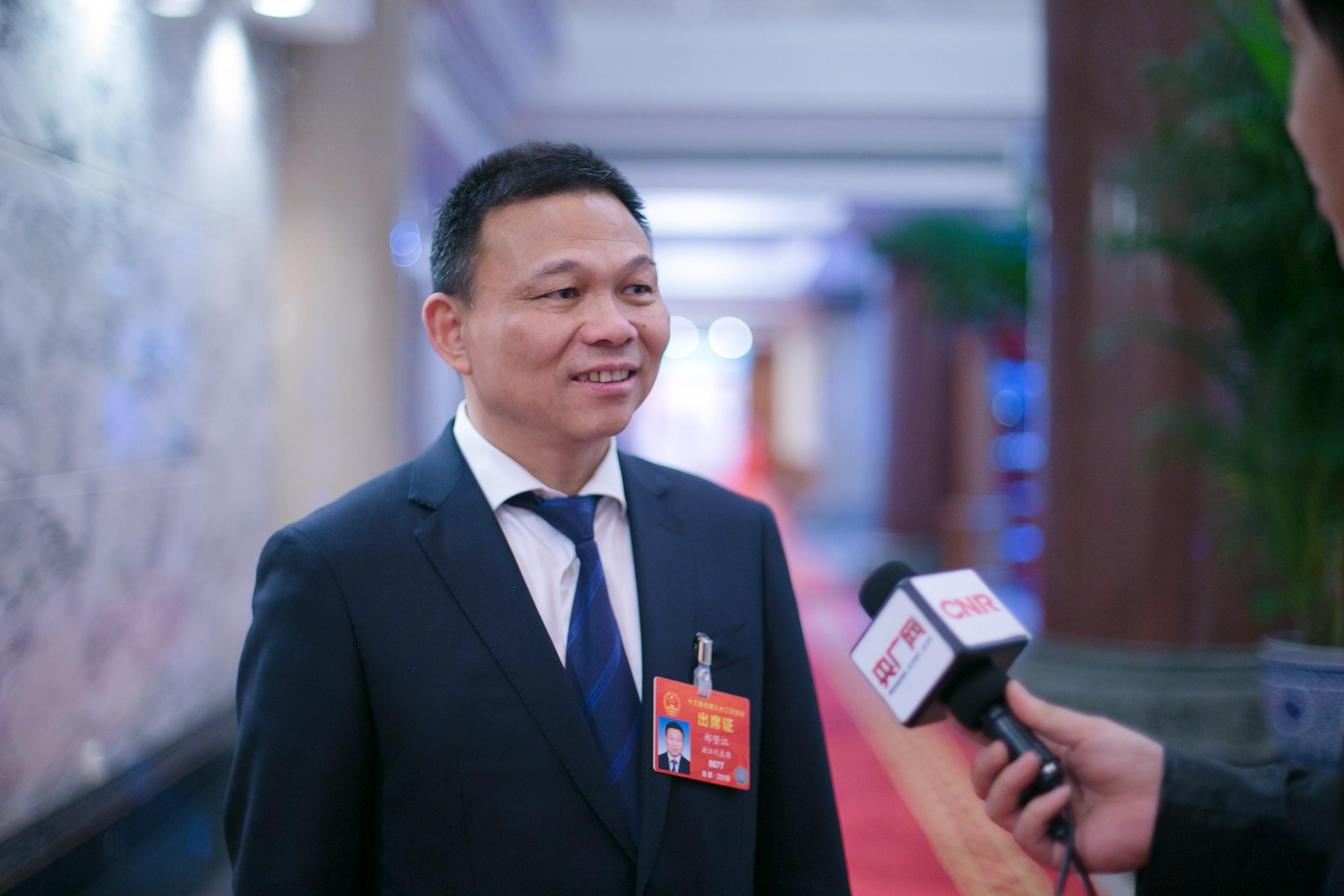 Wife of Chinese billionaire parliamentarian Zheng Jianjiang sues