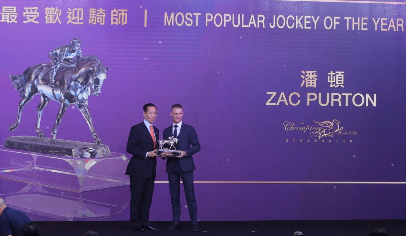 Zac Purton winning the Most Popular Jockey award on Friday night.