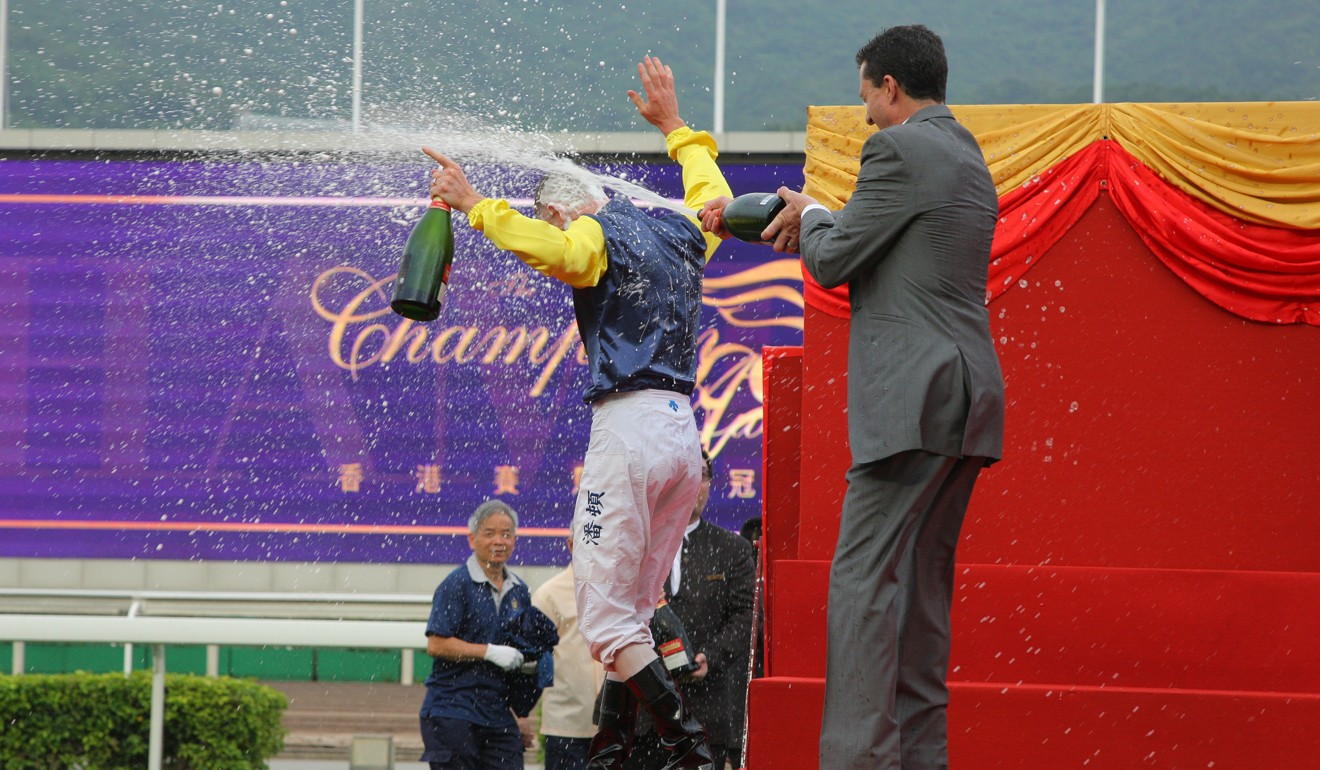 Douglas Whyte douses Zac Purton in champagne.