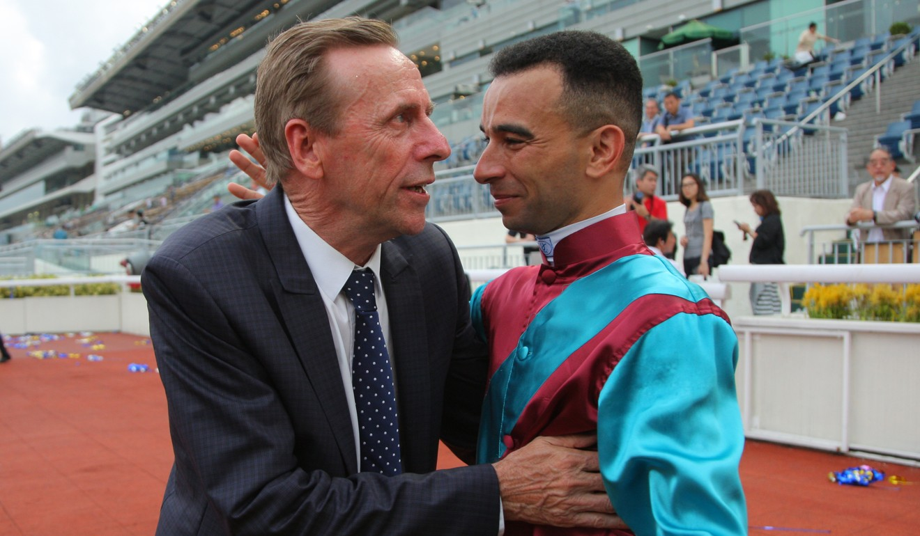 John Size is congratulated by jockey Joao Moreira after his title.