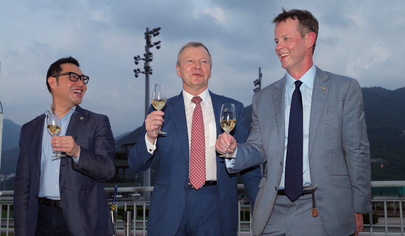 Jockey Club executive director of customer and marketing Richard Cheung, Jockey Club chief executive Winfried Engelbrecht-Bresges and Jockey Club executive director of racing Andrew Harding celebrate after the last race of the season.