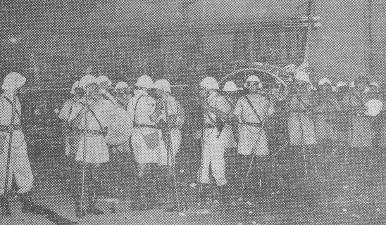 Members of the Pakistan contingent of the Hong Kong Police attend to the 1956 Double Tenth Riots. Photo: Post Magazine