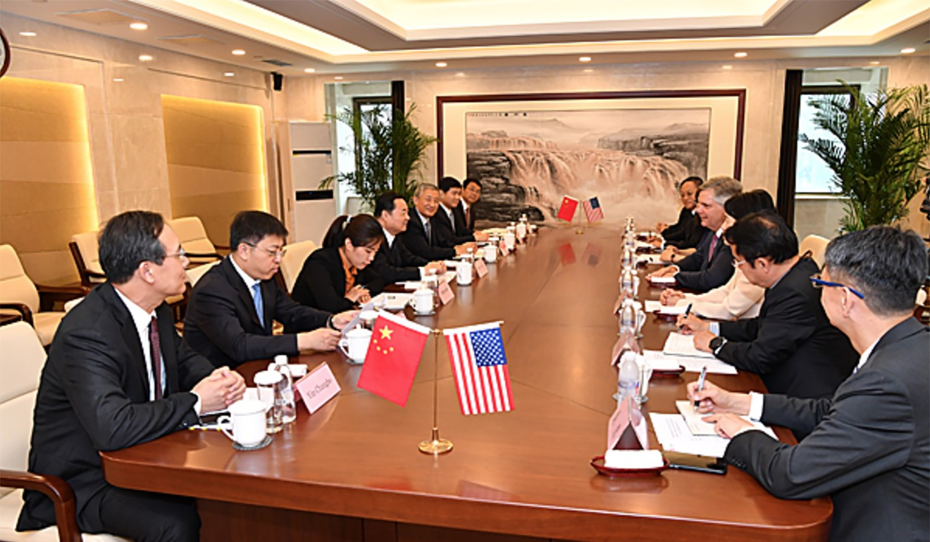 Hao Peng, director of the State-owned Assets Supervision and Administration Commission, pictured at the meeting with Larry Culp, the chief executive of General Electric. Photo: SASAC