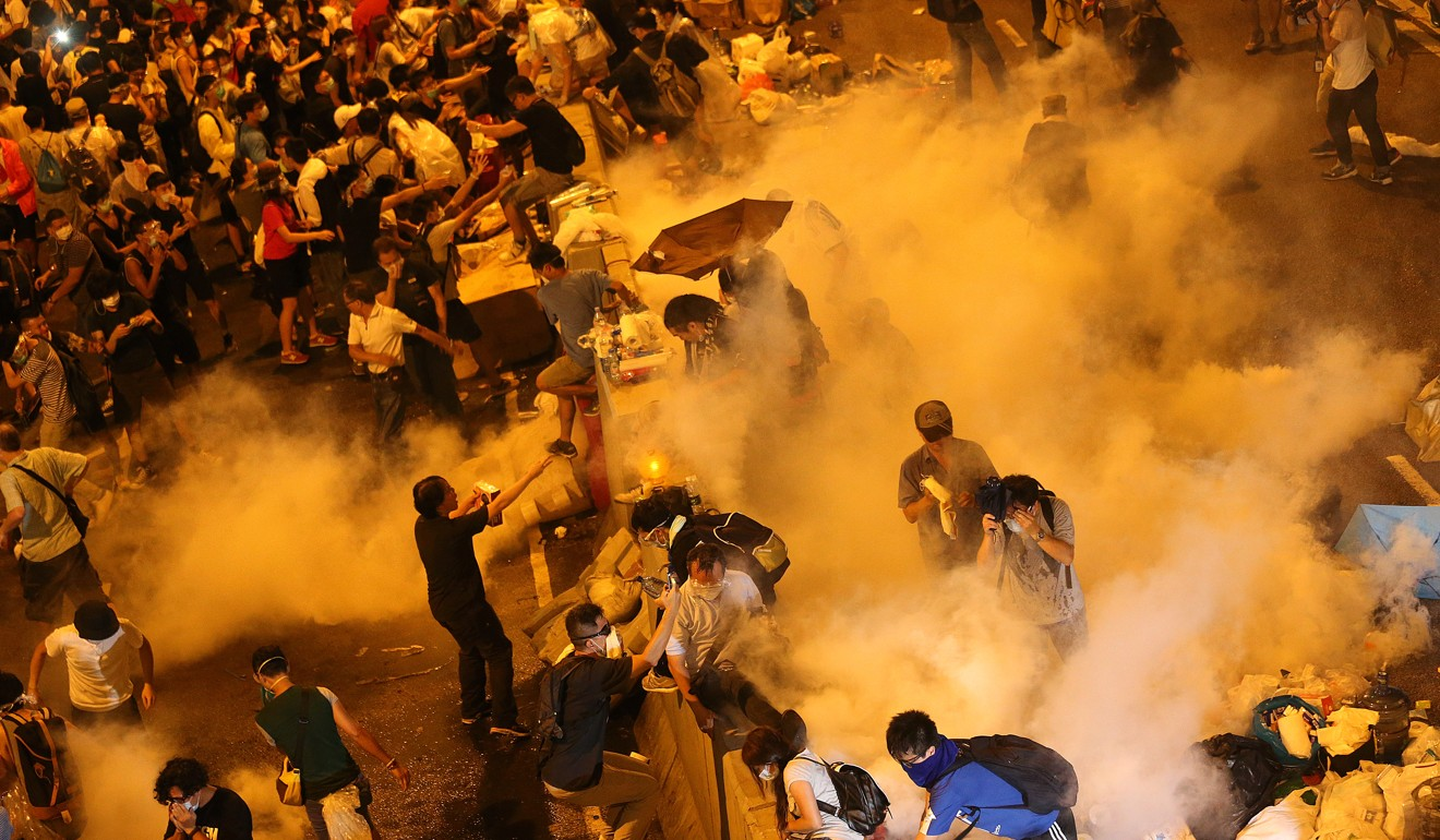 Hong Kong police fire tear gas to disperse Occupy Central protesters in 2014. File photo