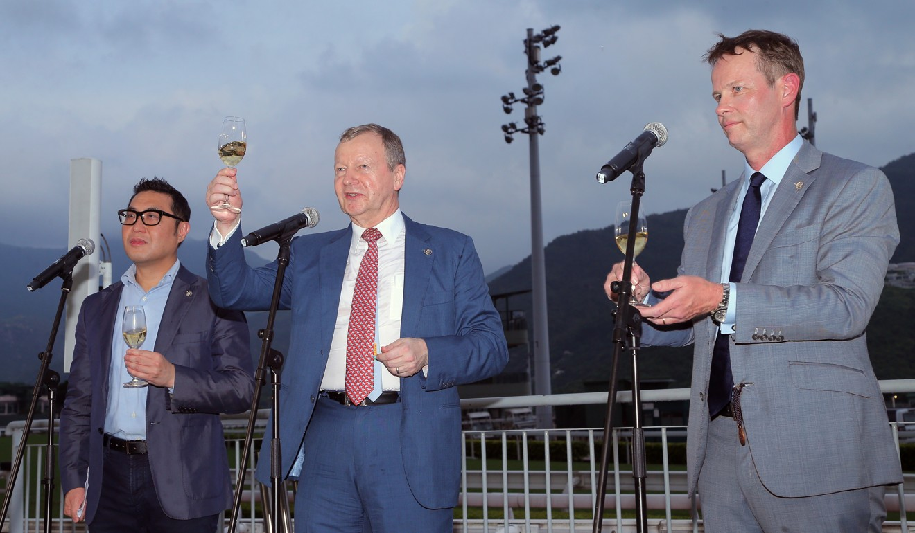 Jockey Club chief executive Winfried Engelbrecht-Bresges (middle) proposes a toast after the final race meeting of the 2018-19 season.
