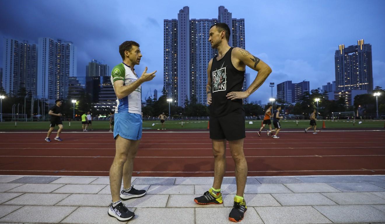 Jeff Campbell giving SCMP reporter Patrick Blennerhassett some tips on running at Cheung Sha Wan. Photo: Jonathan Wong