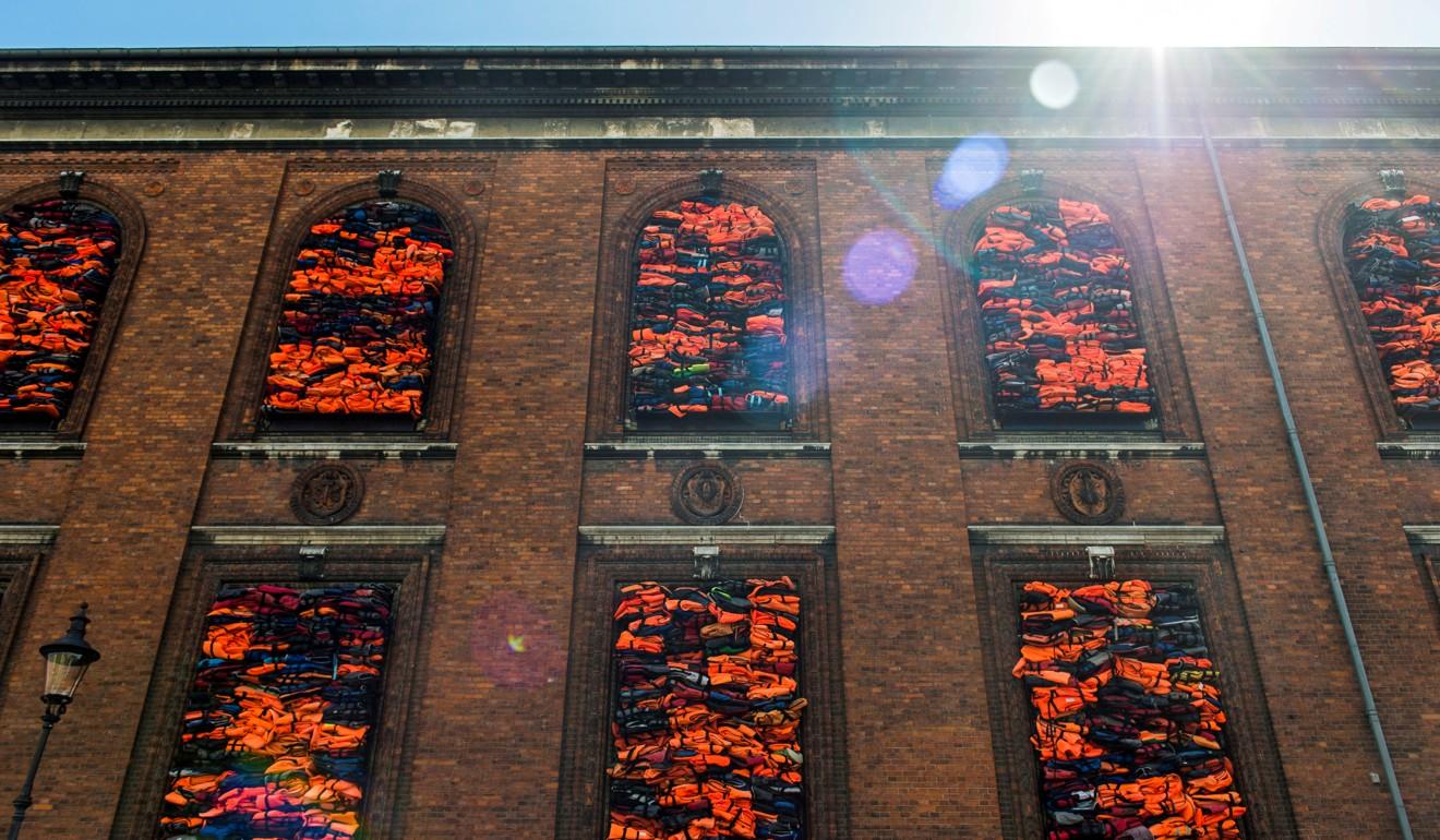 Chinese artist Ai Weiwei awarded US$258,000 damages from Volkswagen dealer in Denmark for advertising infringement