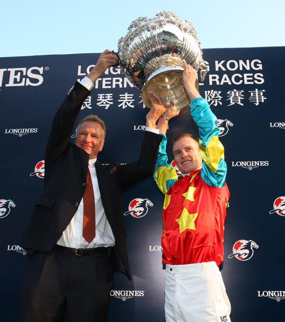 Tony Millard and Zac Purton celebrate the win of Ambitious Dragon.