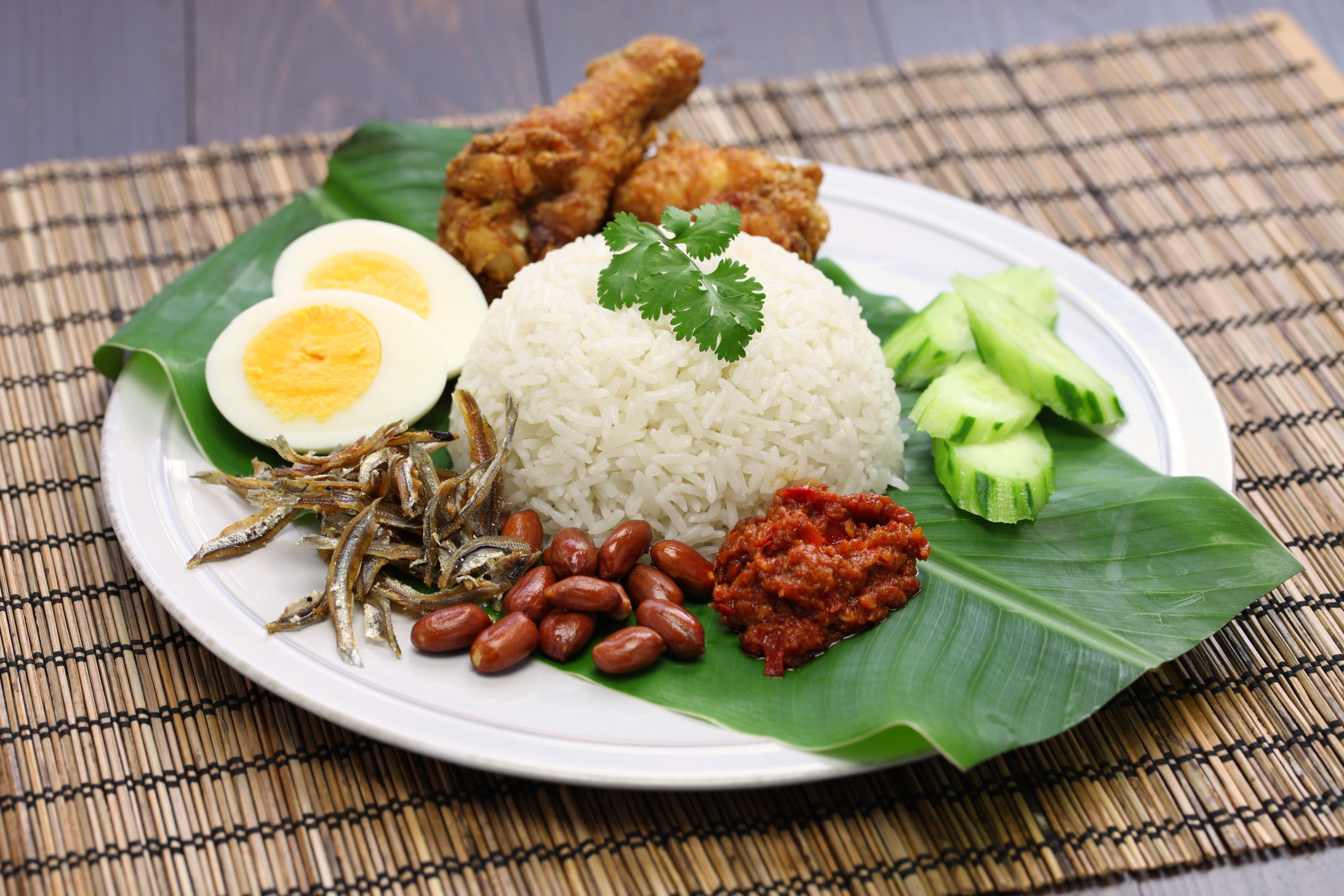 Is nasi lemak from Malaysia or Singapore – and how did it get its name?