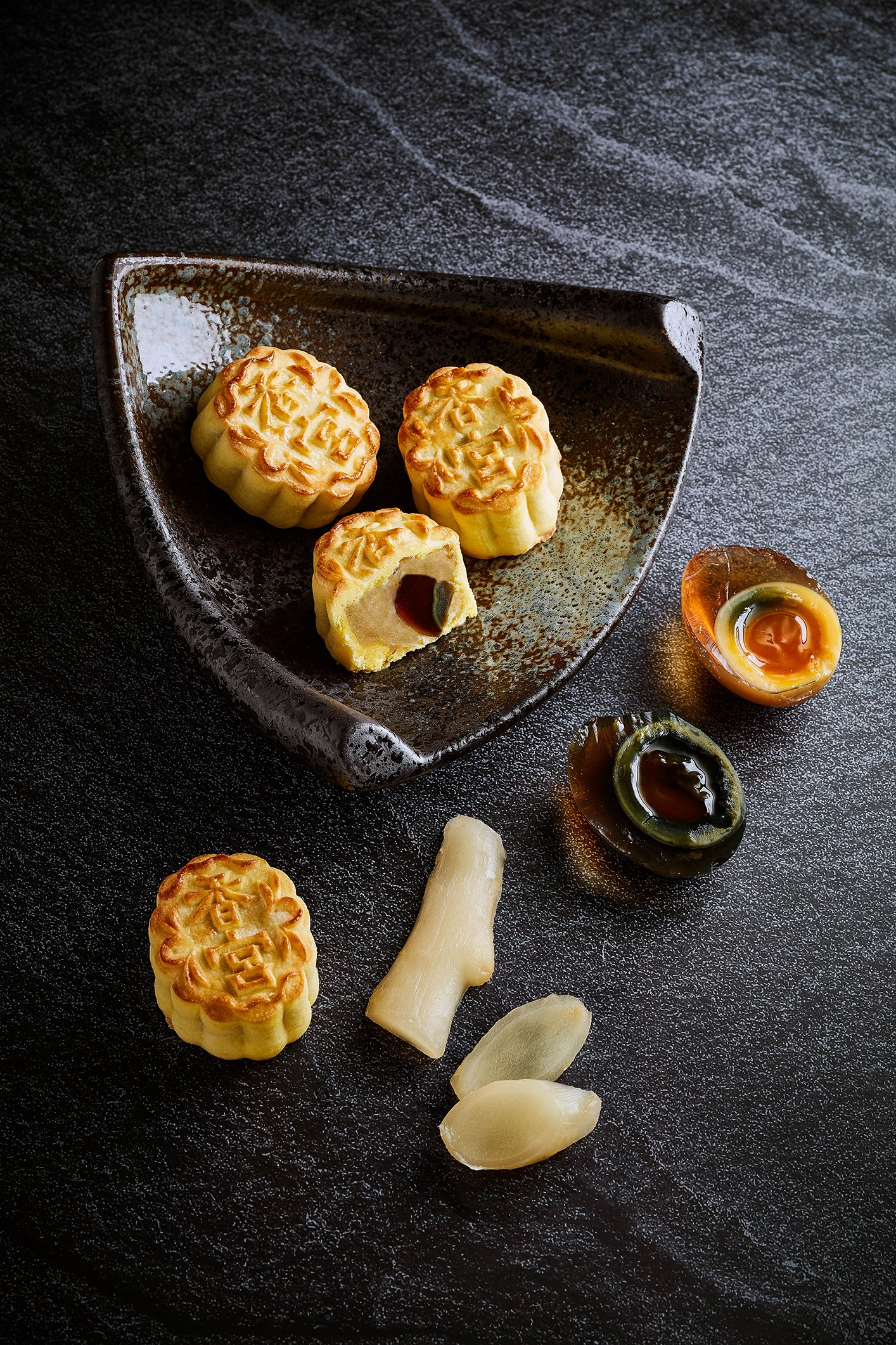 "feac82b02 Kowloon Shangri-La make mini mooncakes with traditional and ""golden""  preserved eggs. The golden eggs have a more attractive golden albumen, an  orange yolk ..."