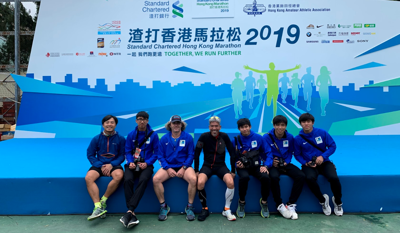 William Luk (left) acts as the official photographer for the Standard Chartered Marathon. He is joined his team and Alman Chan (centre), the Zheng Sheng headmaster. Photo: Handout