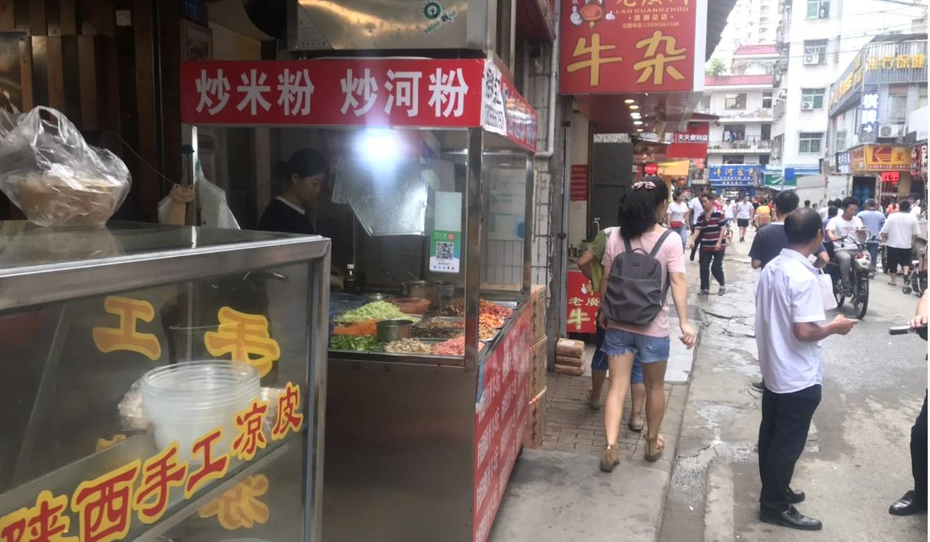 Small shops and street vendors line Baishizhou's bustling alleyways. Photo: Phoebe Zhang