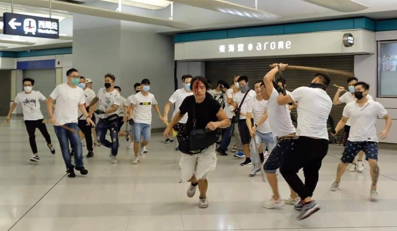 A man in a black T-shirt tries to escape from a mob of attackers in Yuen Long station on Sunday night. Photo: Facebook