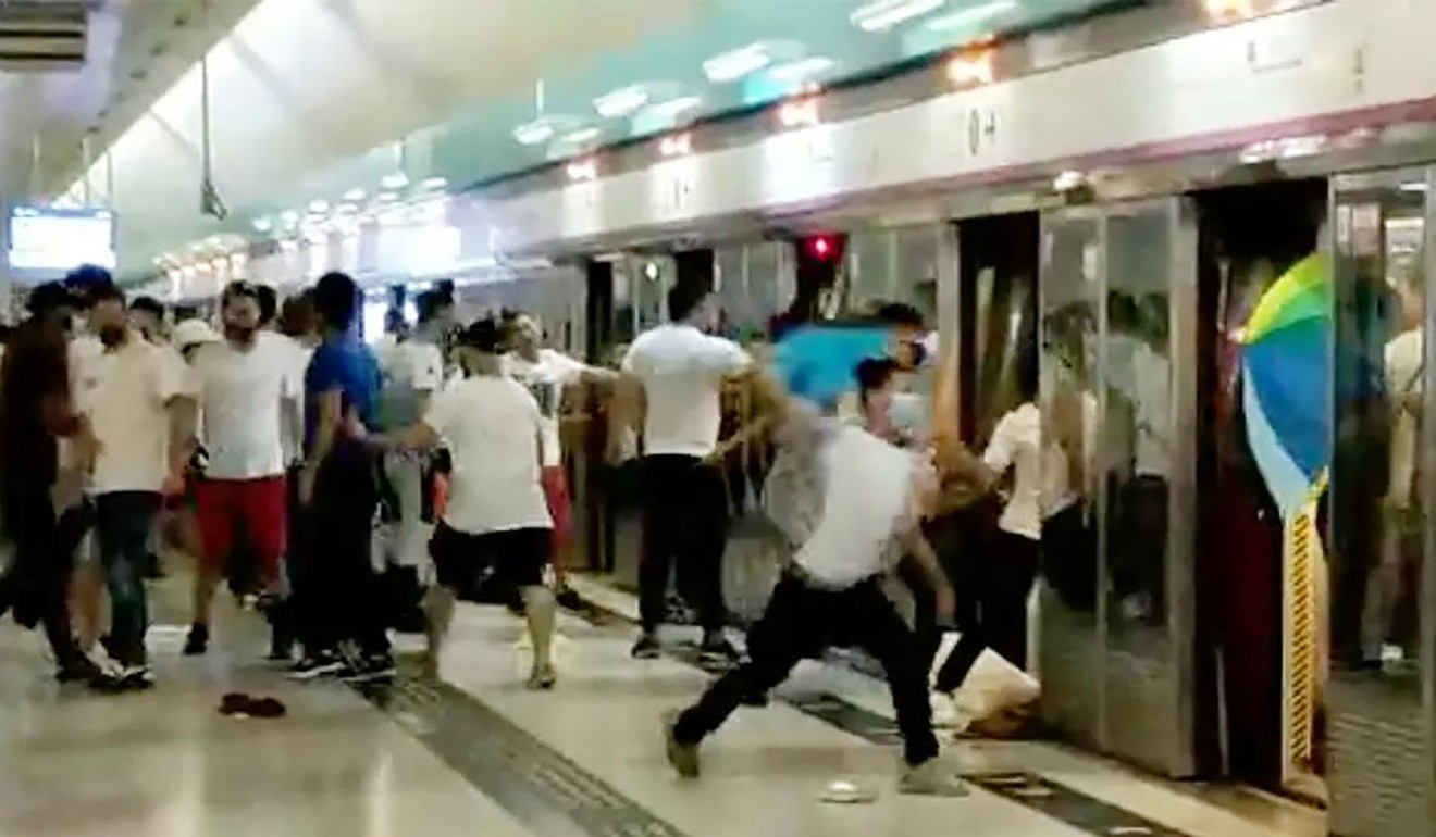 A group of people in white assaulting passengers on Sunday at the Yeung Long MTR station. Photo: Handout