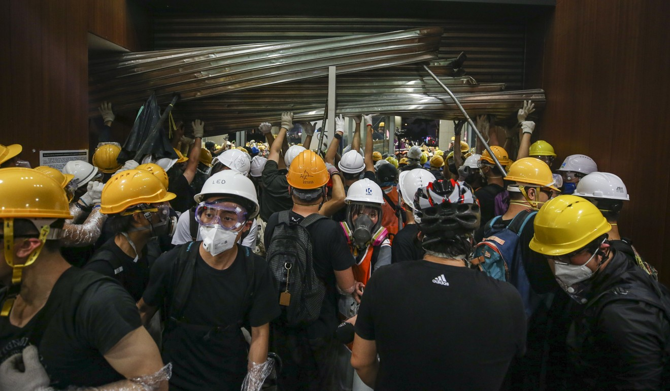 Protesters storm the Legislative Council chamber in Hong Kong on July 1. Photo: Winson Wong