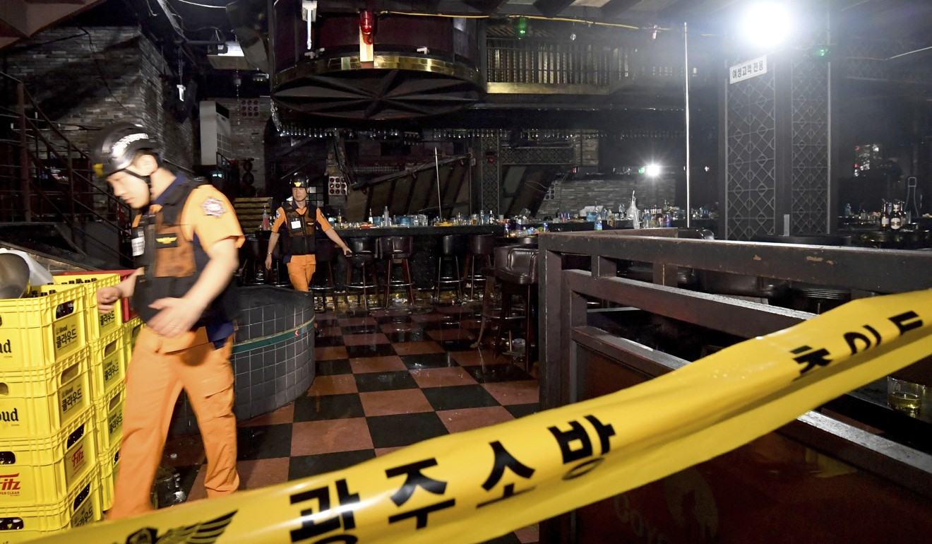 Workers inspect the collapsed internal structure at the nightclub in Gwangju. Photo: AP