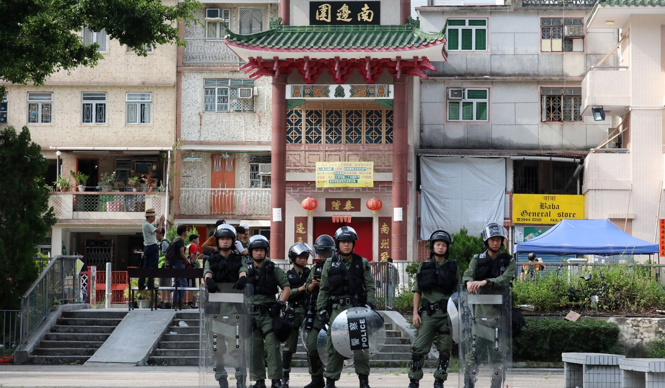 Riot police officers in Yuen Long. Photo: Felix Wong
