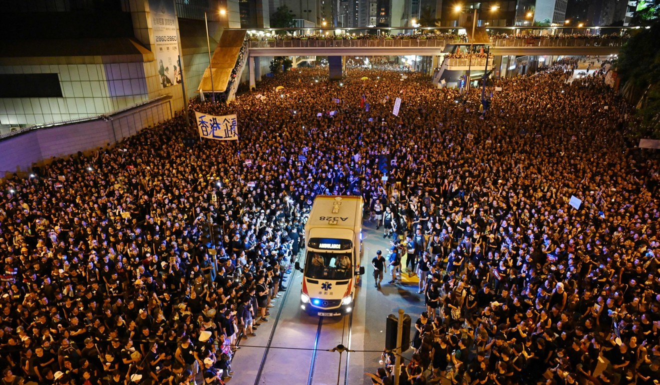 In a sign of Hongkongers' capacity for empathy, protesters make way for an ambulance during a protest last month. Photo: AFP