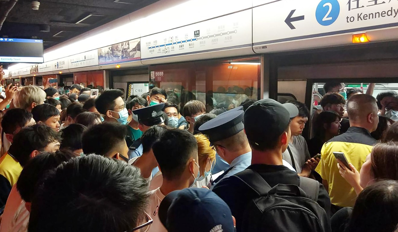 Hong Kong train services return to normal as anti-government