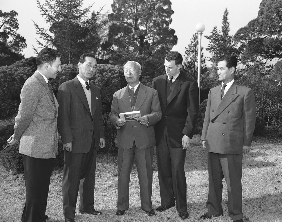 Syngman Rhee (centre), the first president of South Korea, talks with staff of the Associated Press, Korea Pacific Press and the South Korean Office of Public Information in January 1955. Rhee's government heavily censored the domestic press, shaping opinions on matters such as North Korea and Japan and setting a precedent for governments to follow. Photo: AP
