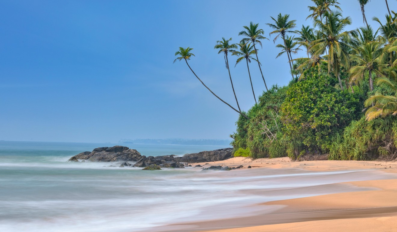 The beach at Dondra, Sri Lanka. The Indian Ocean waves are popular with surfers. Photo: Alamy