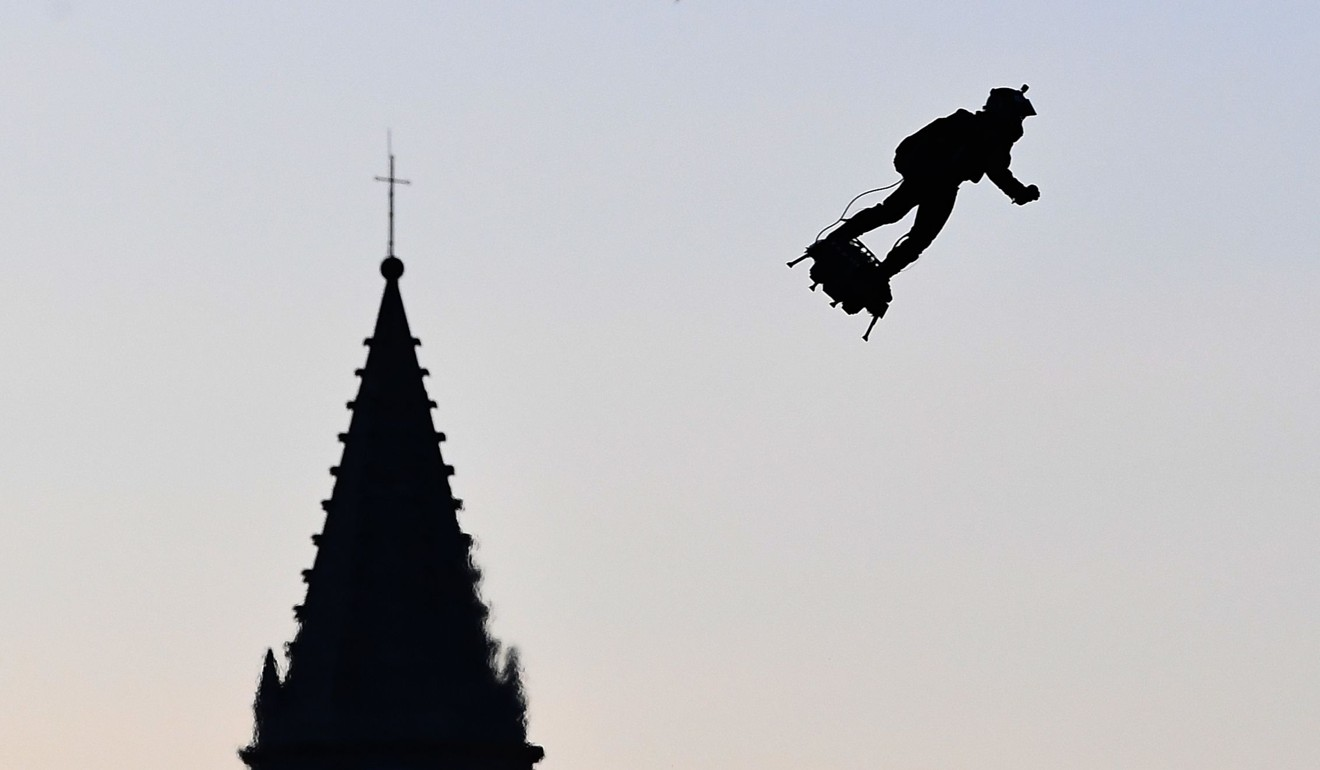 Zapata flies his hoverboard over the old harbour as part of Bastille Day celebrations in Marseille on July 14. Photo: AFP
