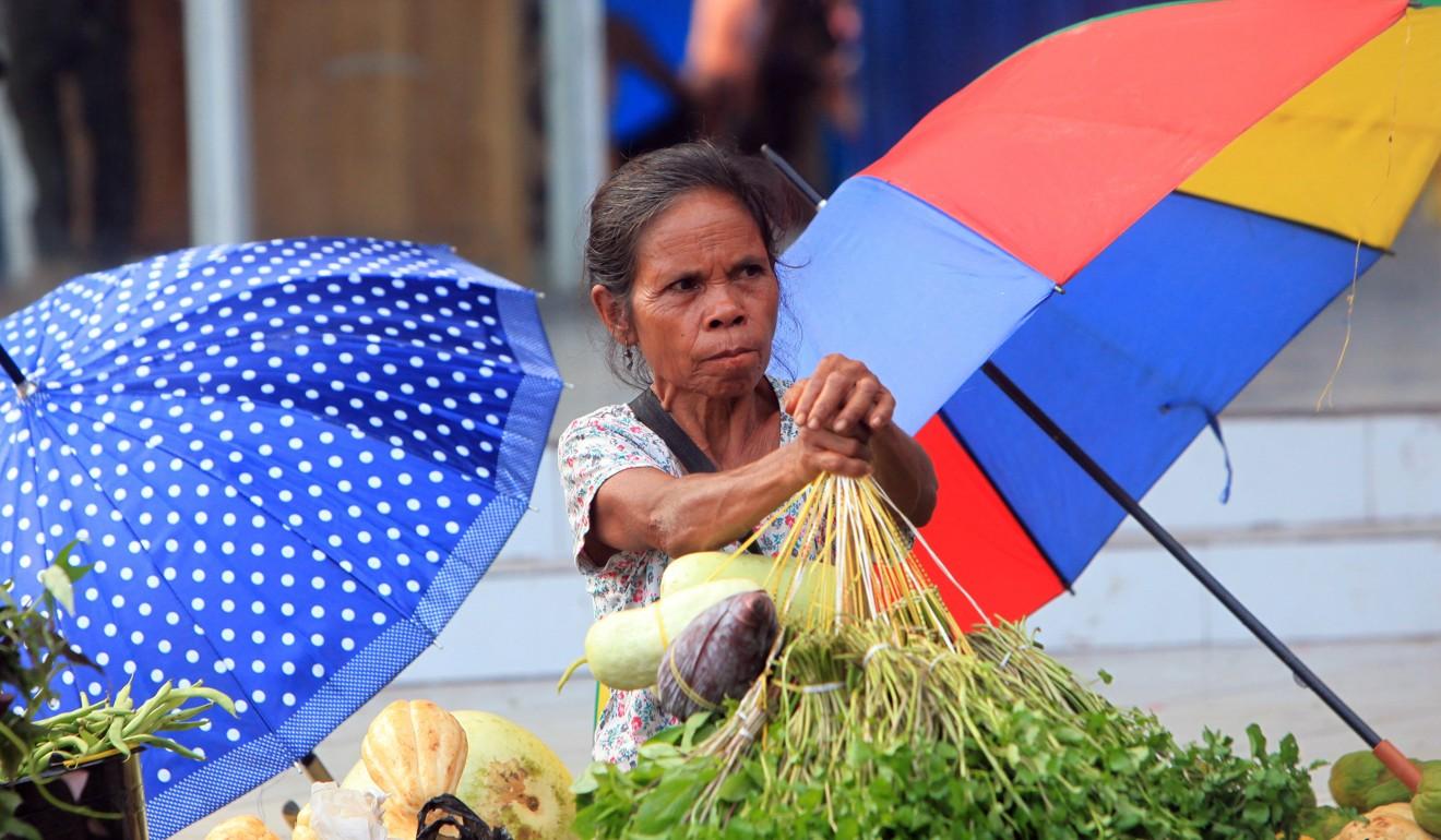 An East Timorese vendor on a sidewalk in Dili. Photo: EPA