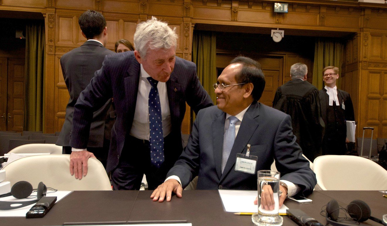 East Timor's foreign affairs minister Jose Luis Gutierrez (right) speaks to Australian lawyer Bernard Collaery during a boundary dispute at the International Court of Justice. Photo: AFP