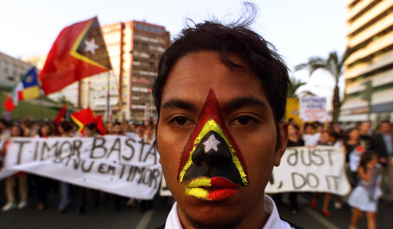 A Timorese refugee at a rally in Lisbon in 1999 calling for East Timor's independence. Photo: Reuters