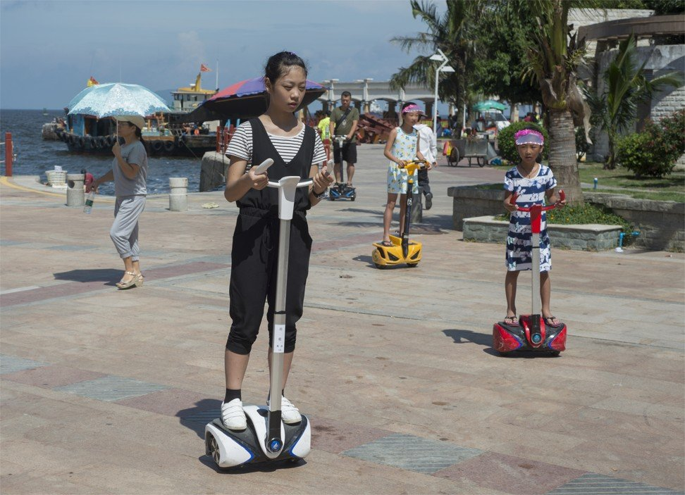Tourists in Zhuhai ride two-wheeled electric scooters. Photo: SCMP Pictures