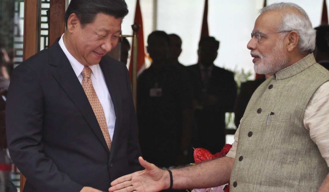 Chinese President Xi Jinping arrives in Ahmadabad, welcomed by Indian Prime Minister Narendra Modi. New Indian census data shows far fewer Chinese call India home. Photo: AP