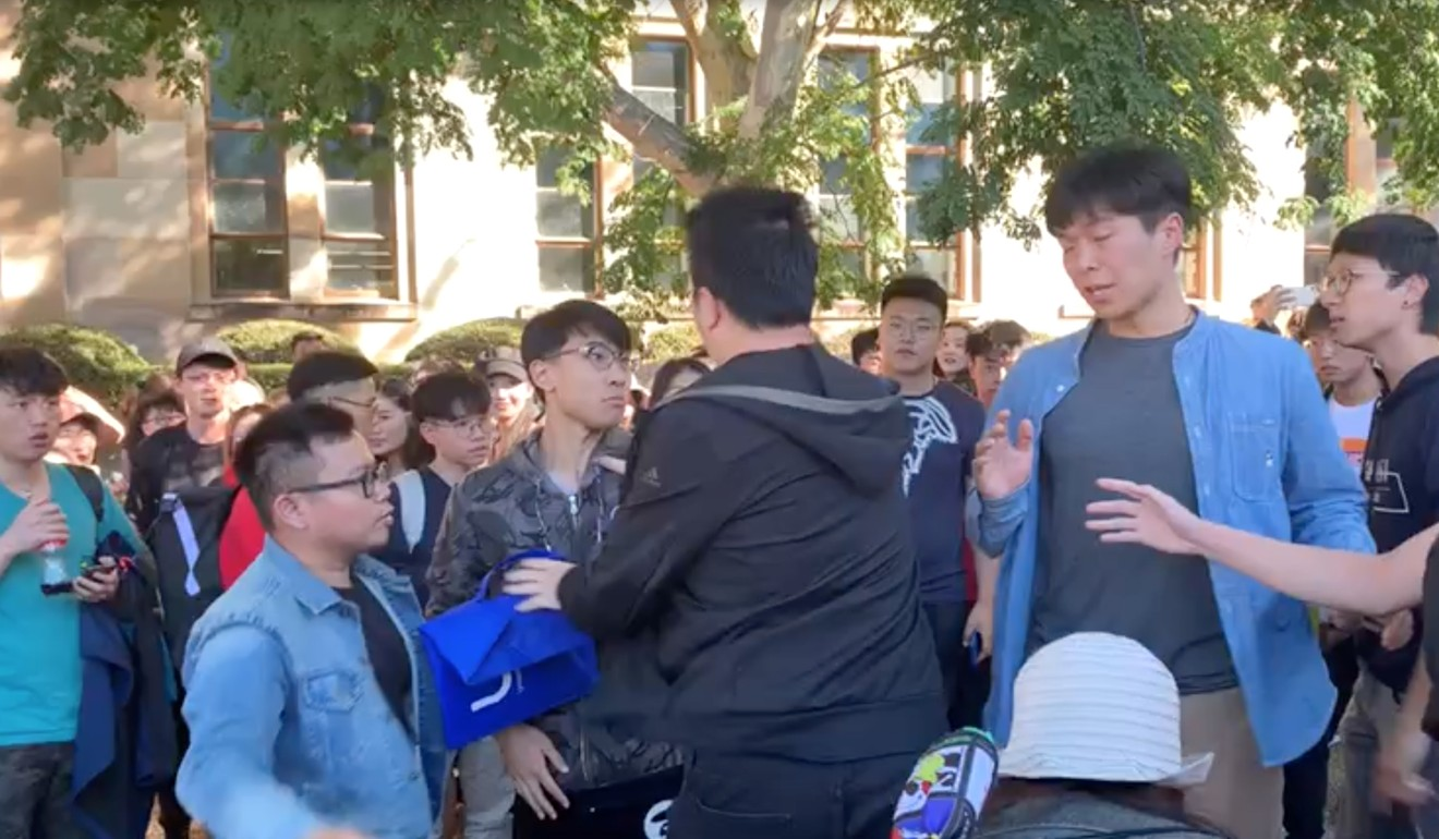 Hong Kong and mainland Chinese students clash during a pro-democracy protest at the University of Queensland in Australia. Since then the organiser says he has received dozens of death threats online. Photo: Twitter