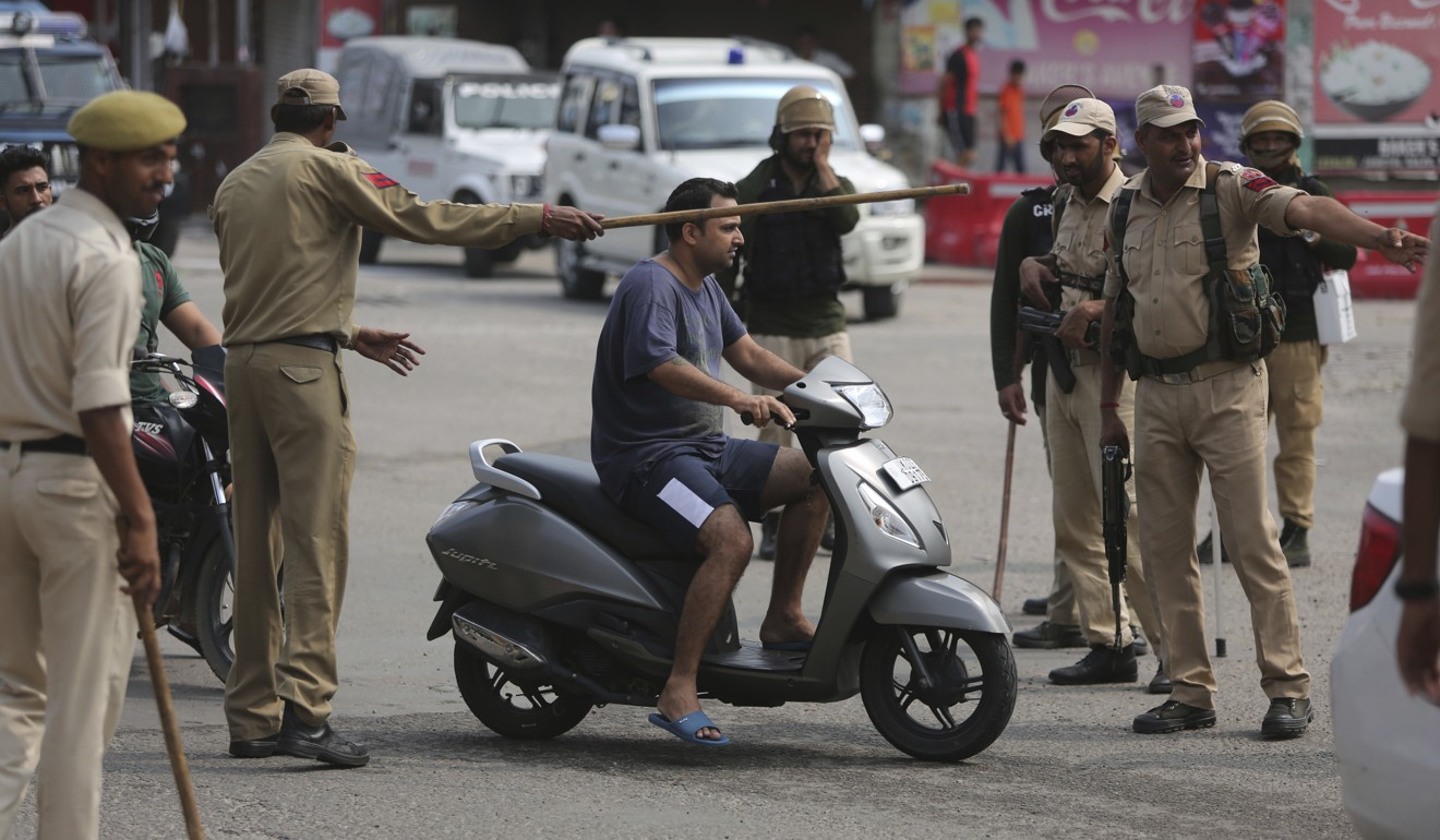 Indian police check the identity of commuters in Jammu on Tuesday. Photo: AP