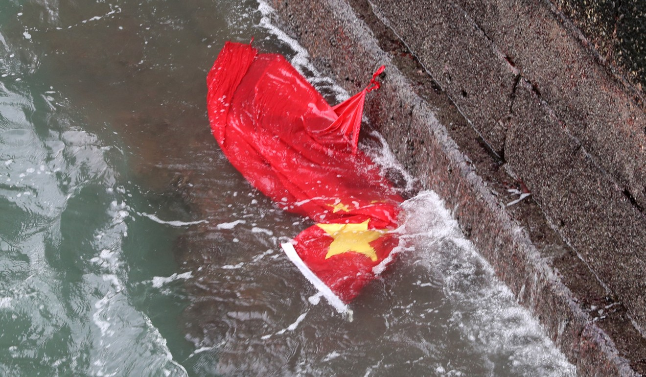 The Chinese flag floats in the harbour at Tsim Sha Tsui, after being torn down by Hong Kong protesters, prompting a troll attack on lawmaker Claudia Mo Man-ching's Facebook page. Photo: Sam Tsang