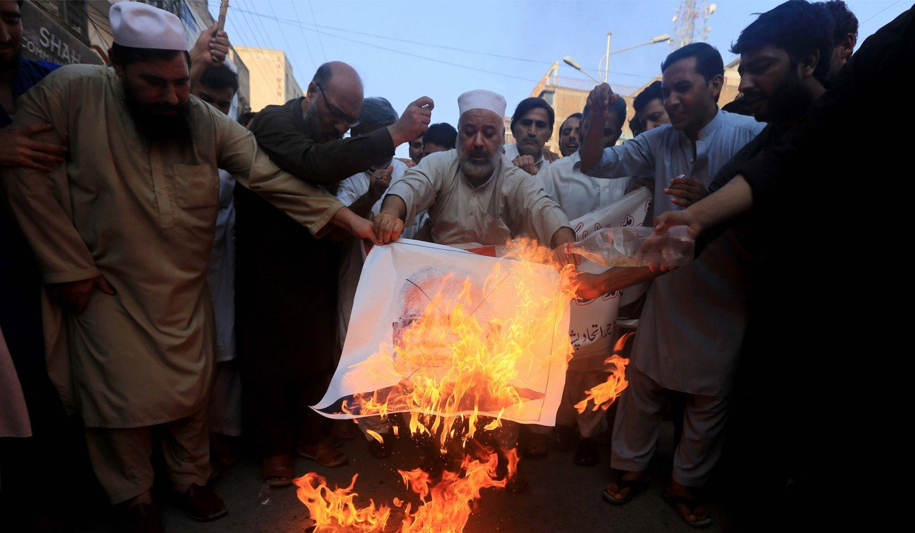 Pakistanis in Peshawar burn a poster of Indian Prime Minister Narendra Modi in protest at his government's decision on Kashmir. Photo: EPA-EFE