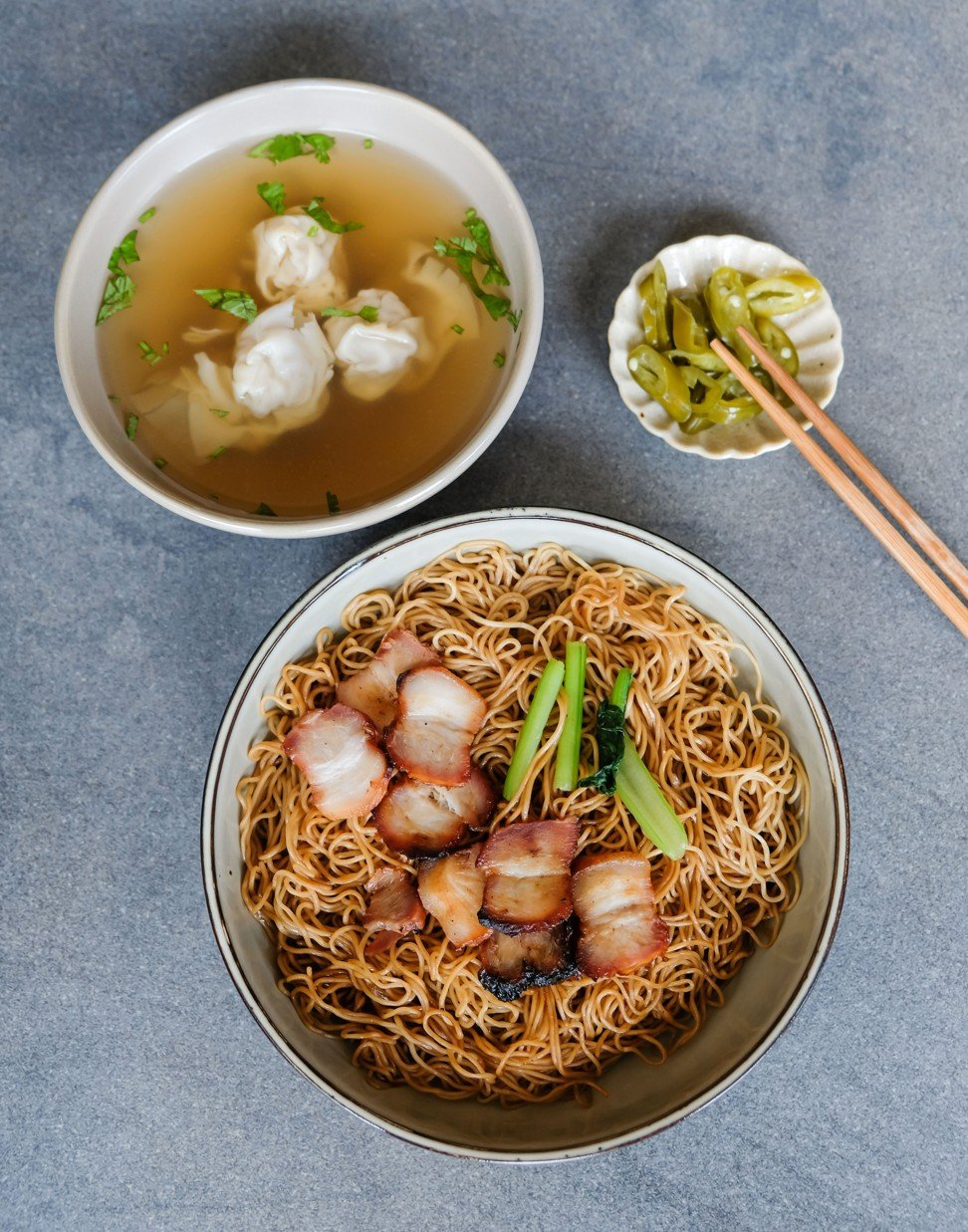 How does Hong Kong's version of wonton noodles compare with Singapore's or Malaysia's?