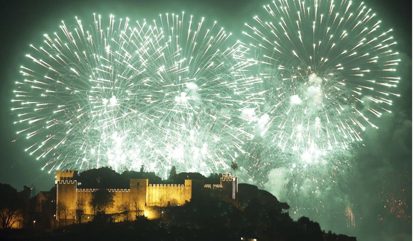 PORTUGAL PROPERTY - Fireworks during New Year festivities behind Lisbon's Saint George castle on January 1, 2019