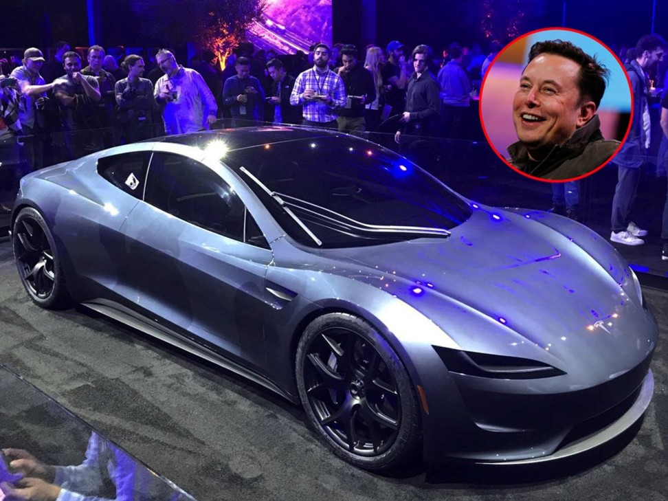 Elon Musk pictured with a second-generation Tesla Roadster. Photos: Reuters