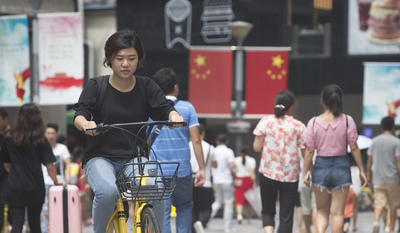 An SCMP reporter uses mobile payment to use a bike sharing service in Shenzhen, China. Photo: SCMP