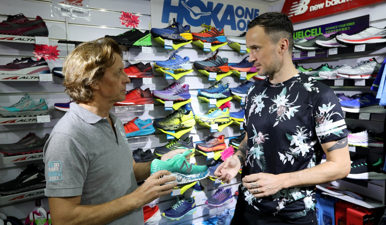 Peter Hopper and SCMP reporter Patrick Blennerhassett look at some running shoes. Photo: Roy Issa