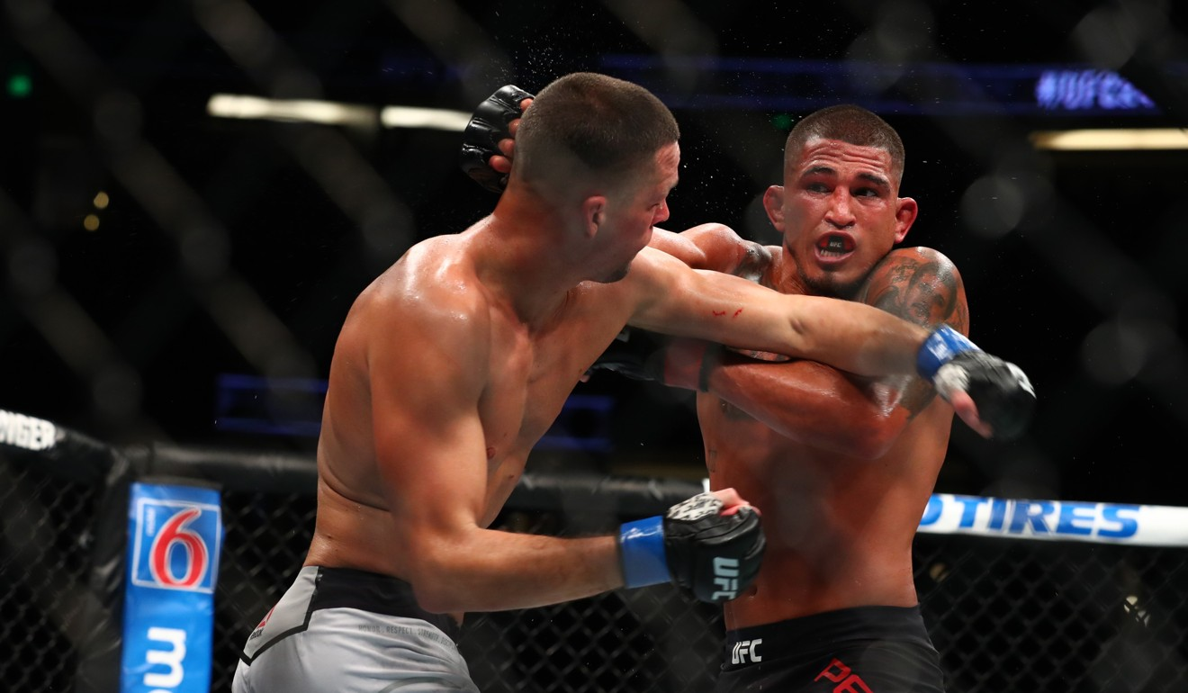 Anthony Pettis throws a punch in the second round against Nate Diaz. Photo: AFP