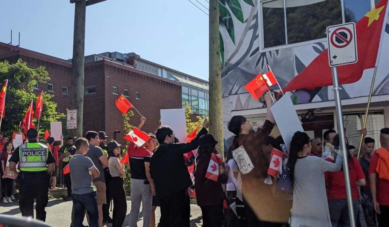 Canadian police escort worshippers as 'bullying' pro-China protesters surround church holding prayers for Hong Kong