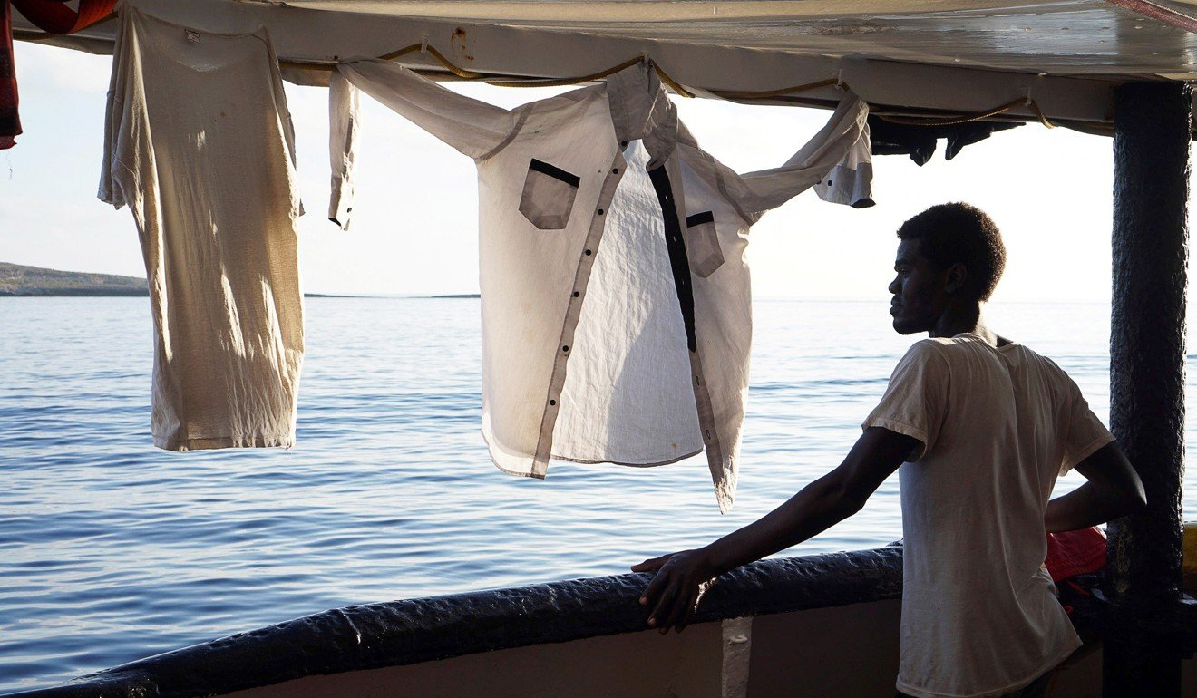 Charity boat the Open Arms rejects Spain's offer to help stranded migrants saying trip from Italy would take too long