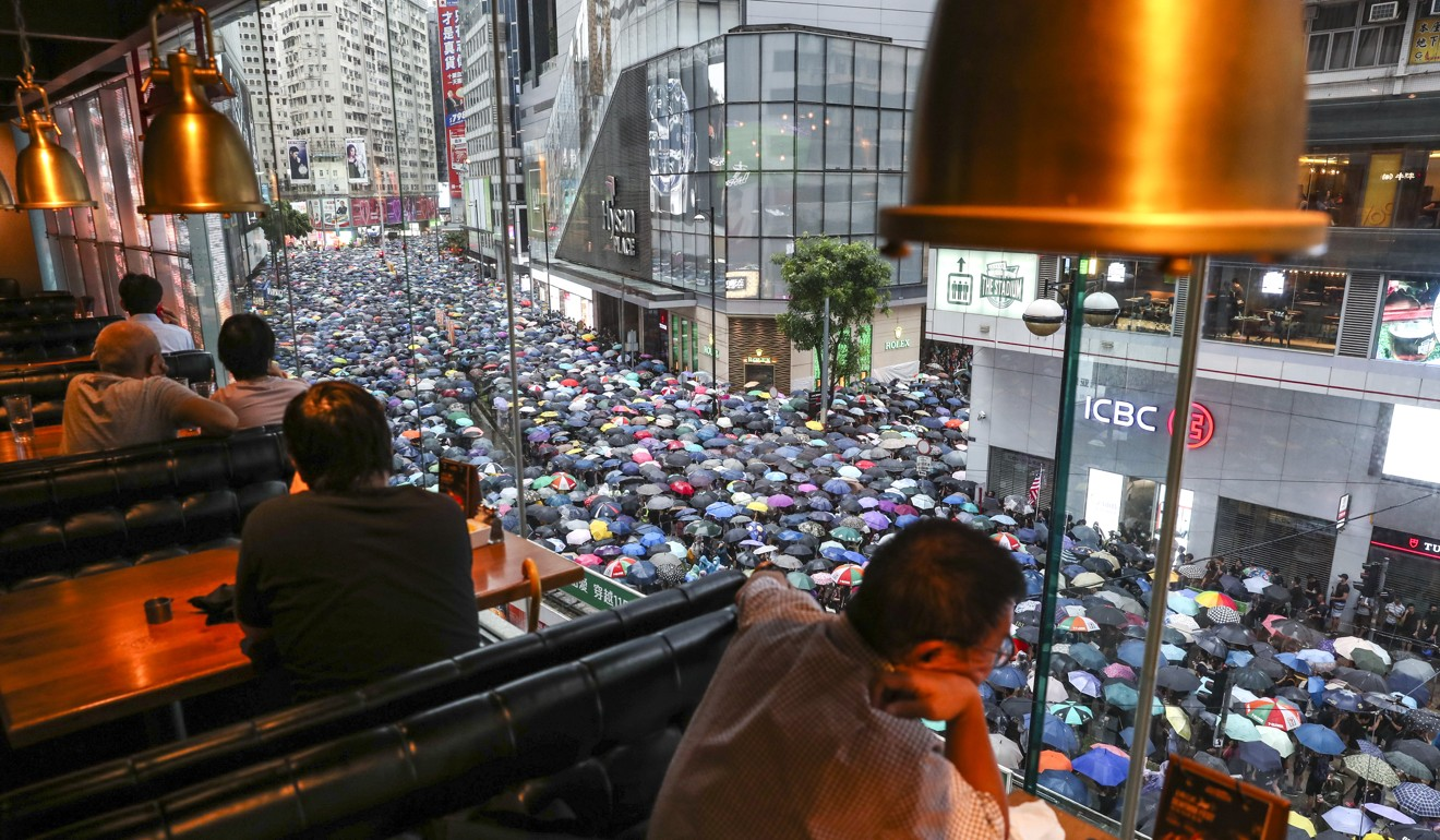 China's Great Firewall no barrier to ugly online battles over Hong Kong protests