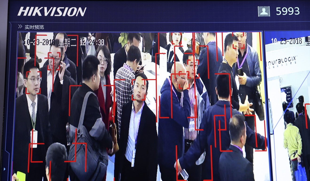 Visitors are tracked by facial recognition technology from state-owned surveillance equipment manufacturer Hikvision at the Security China 2018 expo in Beijing, China. Photo: AP
