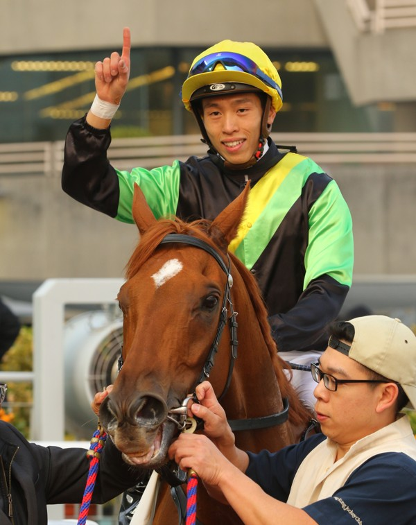 Vincent Ho salutes after a win aboard Ugly Warrior.